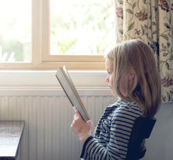 Girl wonders how can i teach my child how to read?